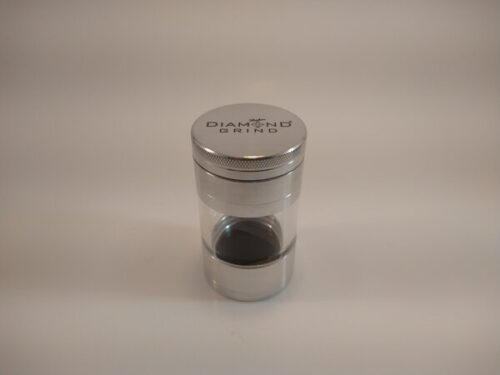 Diamond Shaker 50mm Silver grinder with a large glass collection chamber and a screen.